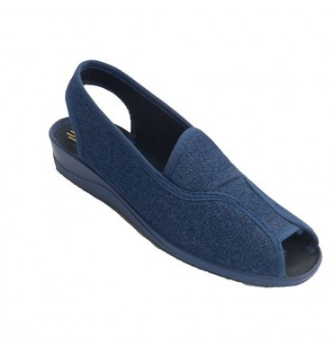 Open woman shoe heel and toe-strap behind Nevada in jeans